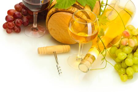 barrel, bottles and glasses of wine and ripe grapes isolated on white photo