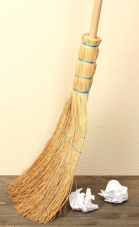 Broom and papers on floor in room photo