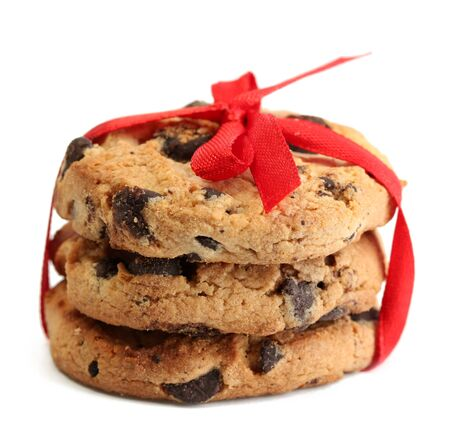 Chocolate chips cookies with red ribbon isolated on white Stock Photo - 14065070