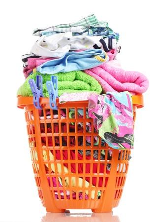 Clothes in orange plastic basket isolated on white Stock Photo - 14070238