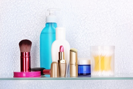 Shelf with cosmetics and toiletries in bathroom Stock Photo - 14072467