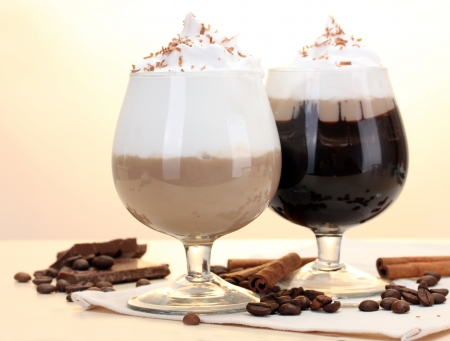 glasses of coffee cocktail on wooden table photo