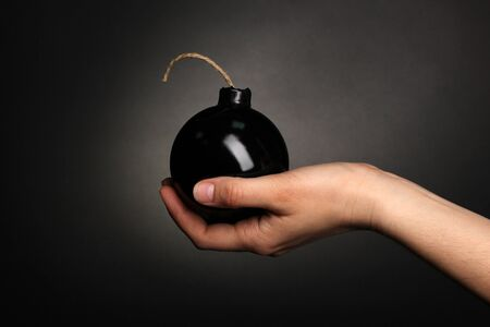 Cartoon style bomb in hand on black background Stock Photo - 14072364