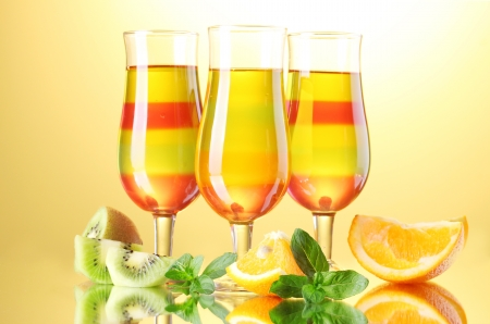 fruit jelly in glasses and fruits on yellow background Stock Photo - 14065231
