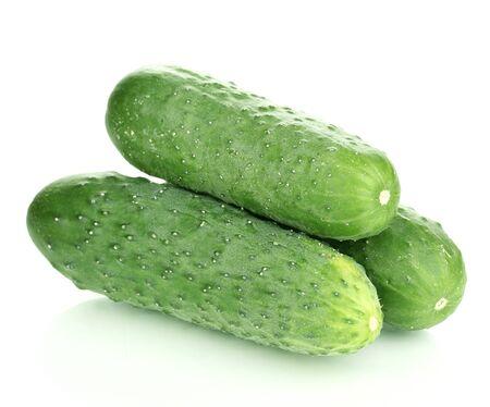 Fresh cucumbers isolated on white photo