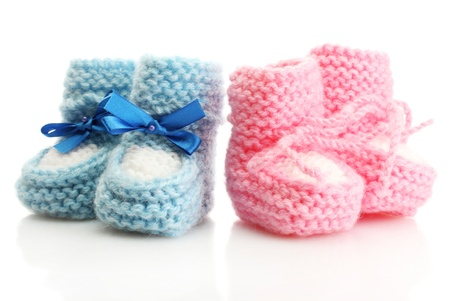 cuddly baby: pink and blue baby boots isolated on white