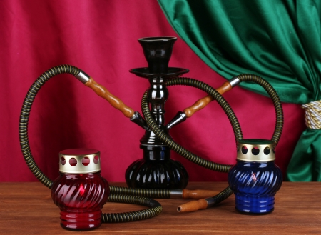 hookah on a wooden table on a background of curtain close-up Stock Photo - 14077780