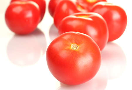 Ripe red tomatoes isolated on white photo