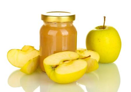 Jar with fruit baby food isolated on white photo