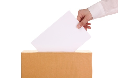 Hand with voting ballot and box isolated on white Stock Photo - 14077403