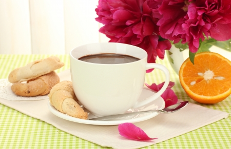 cup hot chocolate, cookies and flowers on table in cafe Stock Photo - 14086342