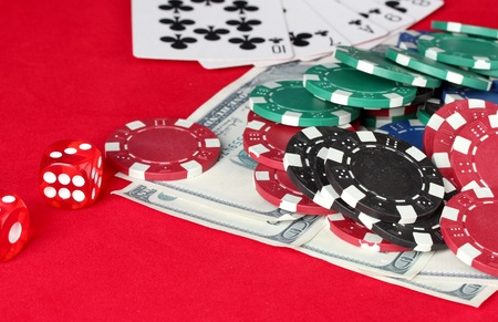 The red poker table with playing cards, poker chips and dollars photo