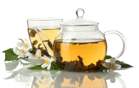 green tea with jasmine in cup and teapot isolated on white photo