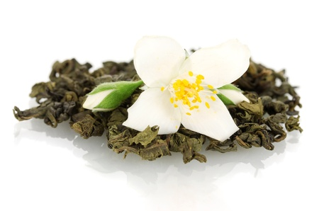 beautiful jasmine flower and dry green tea isolated on white photo