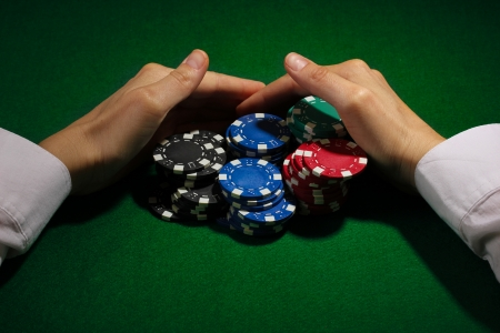 Taking win in poker on green table Stock Photo - 14092206