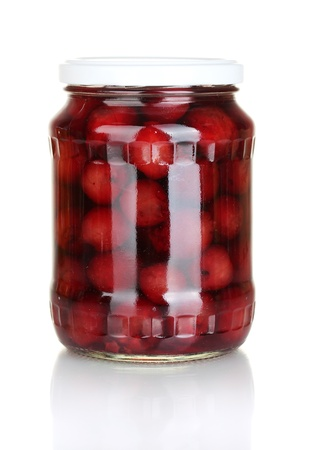 Jar of canned cherries isolated on white photo