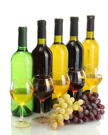 vino: bottles and glasses of wine and ripe grapes isolated on white