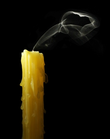 extinguish: candle with abstract smoke on black background