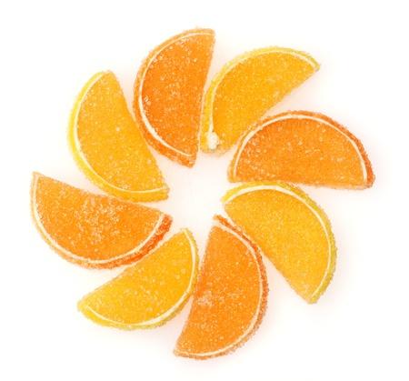 orange jelly candies isolated on white photo