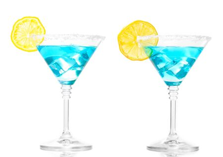 Blue cocktail in martini glasses isolated on white photo