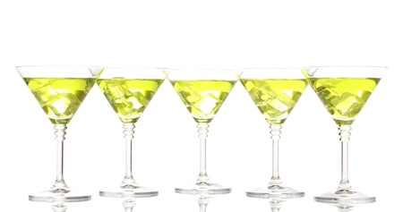 Yellow cocktail in martini glasses isolated on white photo