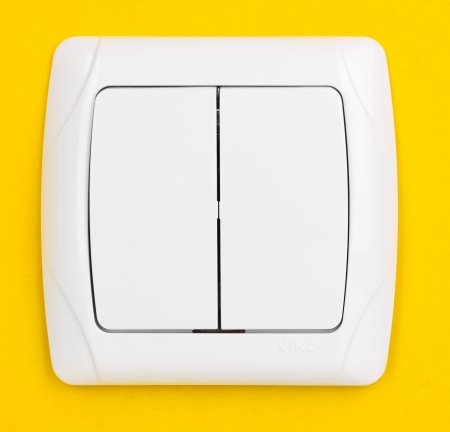Modern light switch on yellow background Stock Photo - 14098206