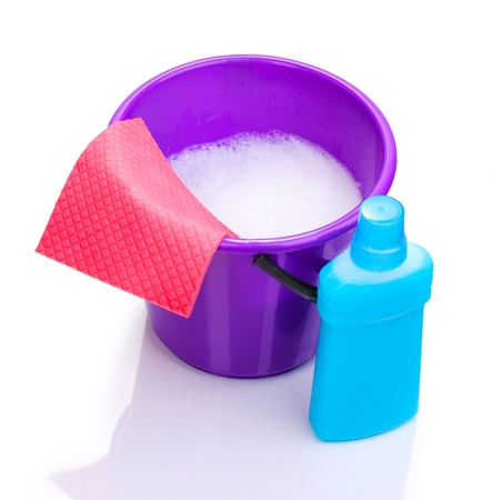 bright housekeeping: Bucket with detergent and cloth for cleaning isolated on white