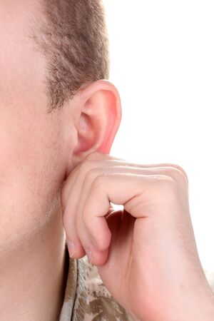 Human ear and hand close-up isolated on white photo