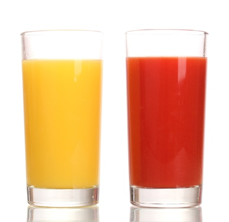 Tropical juices in glasses isolated on white photo