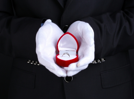 Man's hands holding ring in box Stock Photo - 14098702