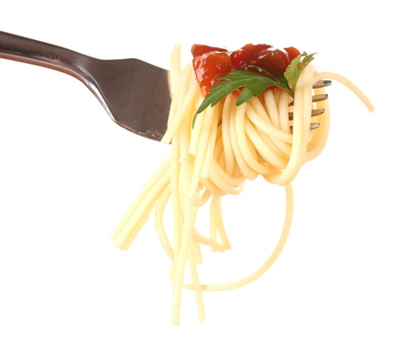 Delicious spaghetti on a fork close-up on white background photo