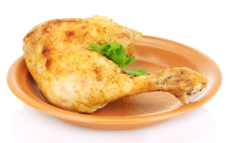 chicken leg: roasted chicken leg with parsley in the plate isolated on white