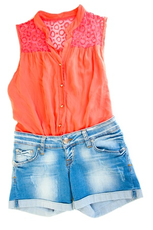 Womens blouse and denim shorts isolated on white photo