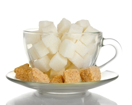 lump: white refined sugar and Lump brown cane sugar cubes in glass cup isolated on white