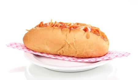 Appetizing hot dog on plate isolated on white photo