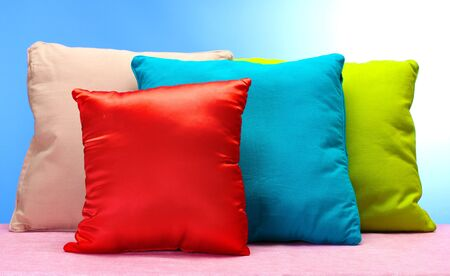 bright pillows on blue background Stock Photo - 14111300