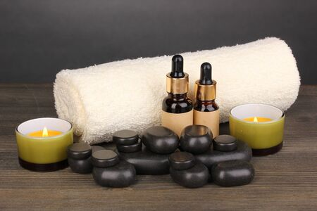 Spa setting on wooden table on grey background photo