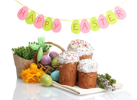Beautiful Easter cakes, colorful eggs in basket and willow twigs isolated on white photo