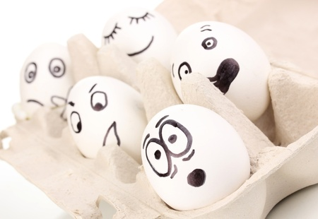 White eggs with funny faces photo