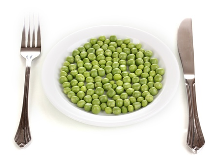 Green peas on plate isolated on white Stock Photo - 14169694