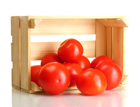Ripe red tomatoes in wooden box isolated on white photo