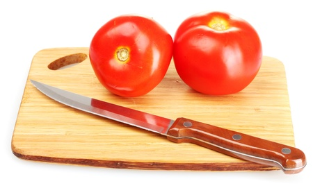 Ripe red tomatoes and knife on cutting board isolated on white photo