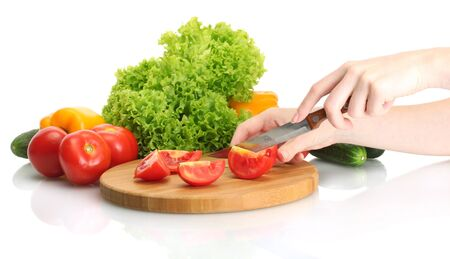 woman hands cutting vegetables on kitchen blackboard photo