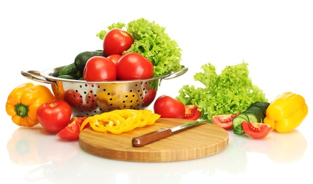 fresh vegetables and knife on cutting board isolated on white Stock Photo - 14170364