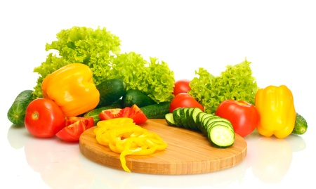 fresh vegetables on cutting board isolated on white photo