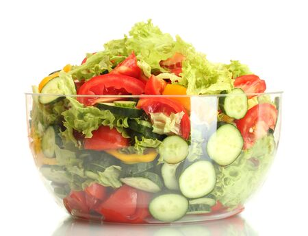 fresh vegetable salad in transparent bowl isolated on white photo
