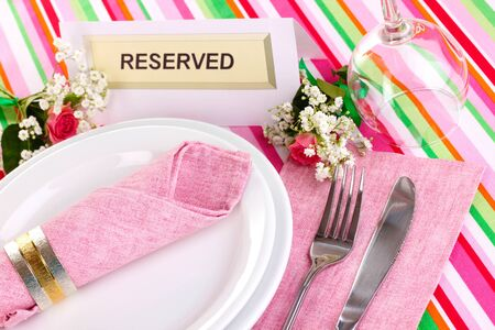 Table setting with reserved card in restaurant Stock Photo - 14157074