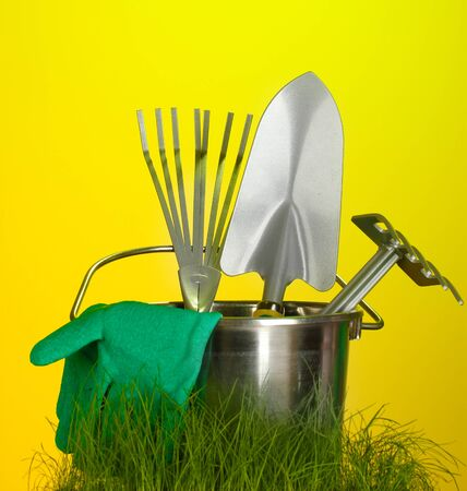 garden tools on grass on bright colorful background close-up photo