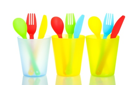 bright plastic disposable tableware isolated on white background Stock Photo - 14160403