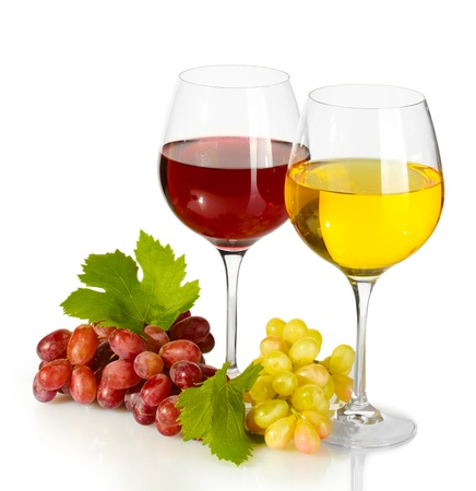 glasses of wine and ripe grapes isolated on white photo